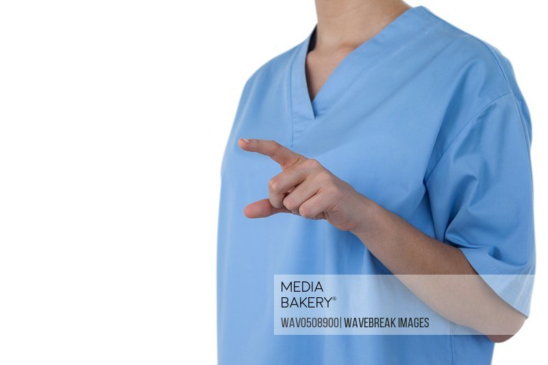 Mid-section of female doctor using digital screen