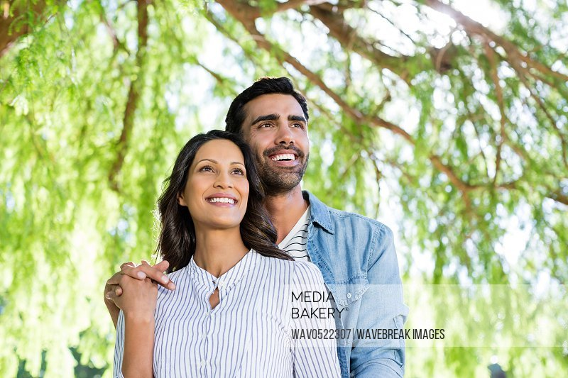 Portrait of couple smiling in park