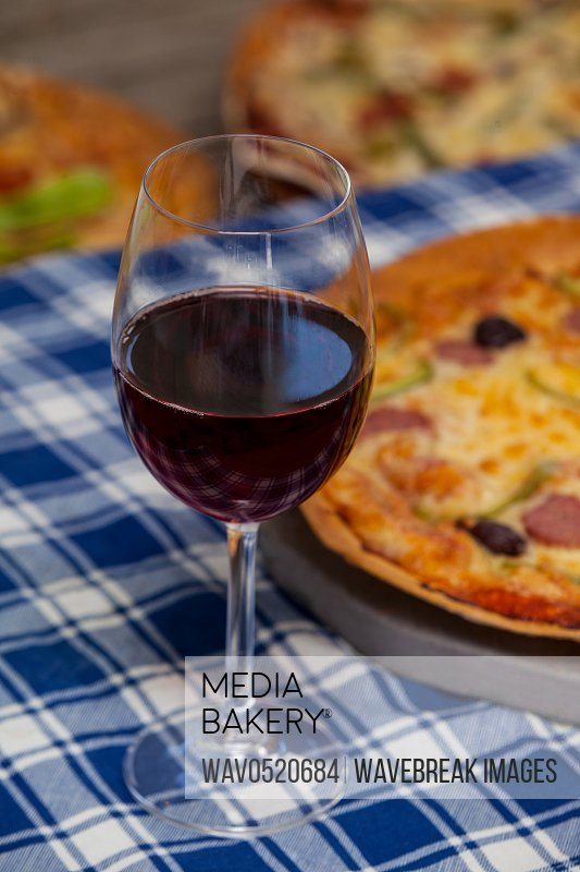 Delicious pizza with a glass of red wine