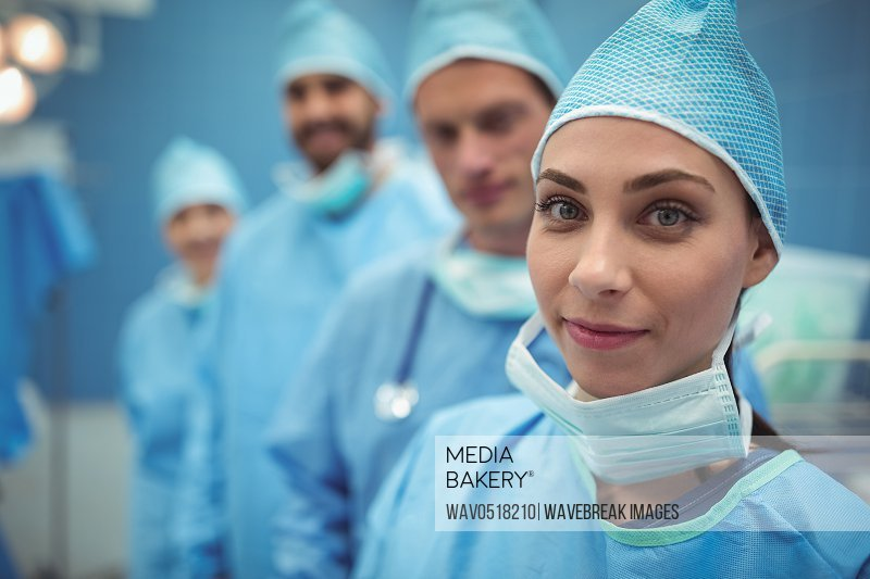 Portrait of female surgeon standing in operation theater