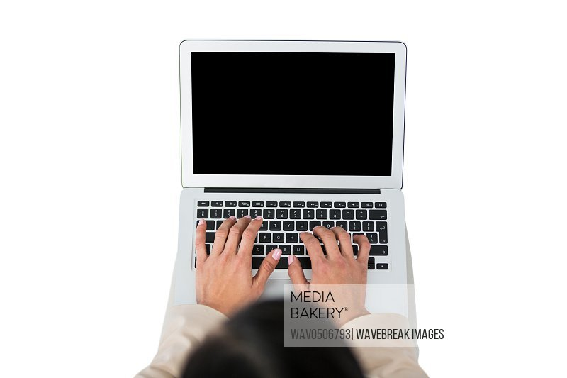 Businesswoman using laptop against white background