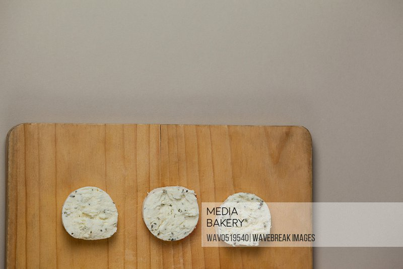 Slices of cheese on chopping board