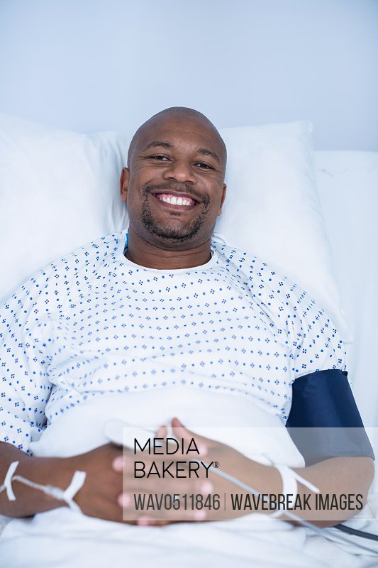 Portrait of male patient resting in ward of hospital