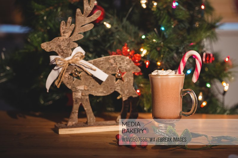 Cup of coffee and christmas decoration on wooden table during christmas time