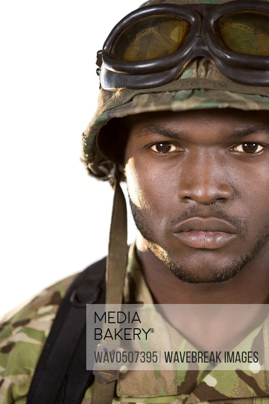 Close-up of confident soldier against white background