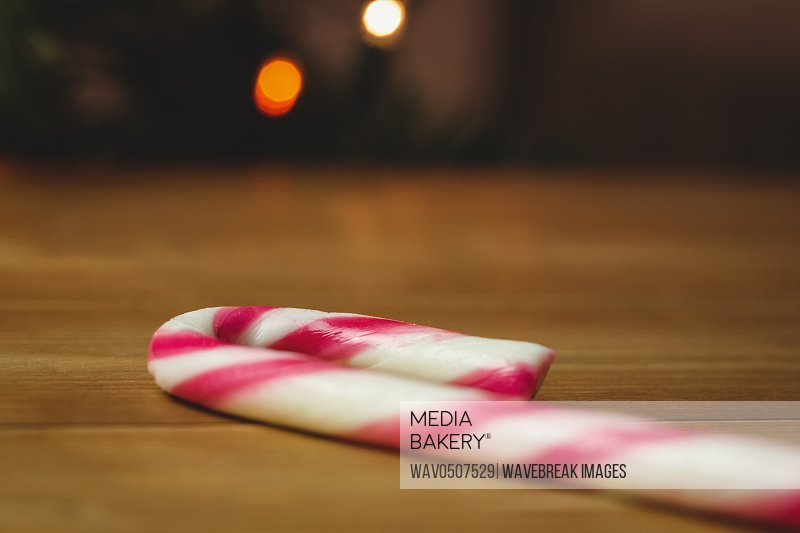 Candy cane on wooden table during christmas time