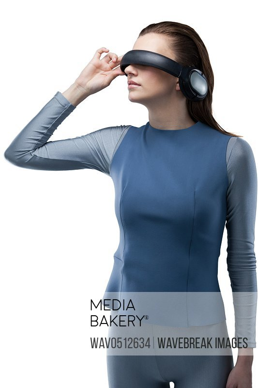 Beautiful woman using virtual reality headset against white background