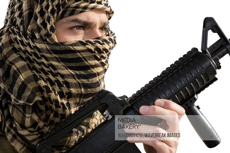 Soldier holding a rifle against white background