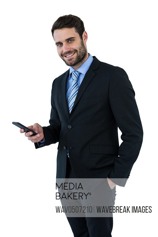 Portrait of businessman text messaging on mobile phone on white background