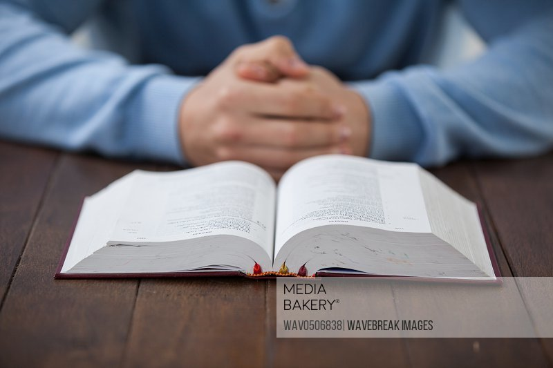 Man sitting at desk with a bible
