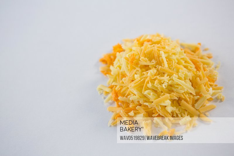Heap of grated cheese on a white background