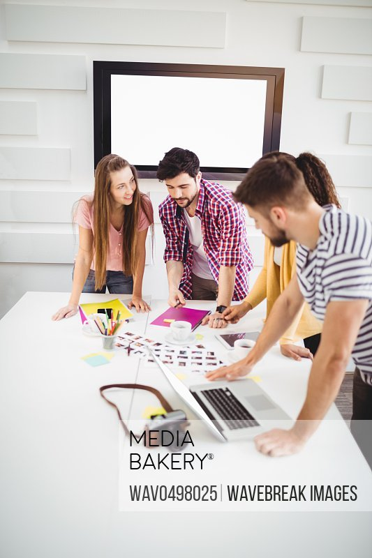 Young executives working in creative office