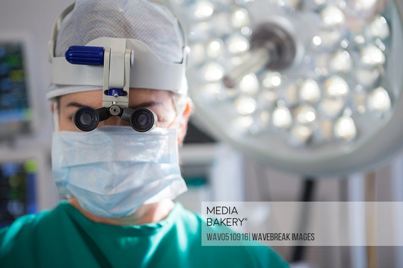 Close-up of surgeon wearing surgical loupes in operation theater