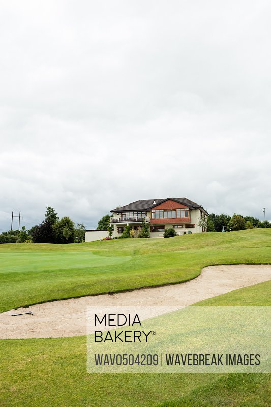 View of beautiful house from golf course