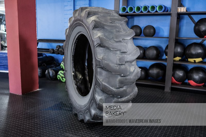 Rubber tire balanced on floor in gym