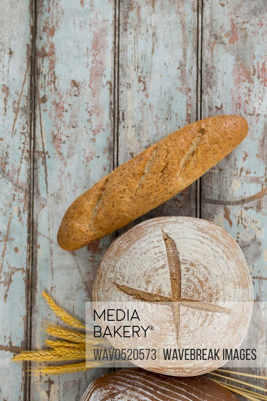 Bread loaves on wooden table