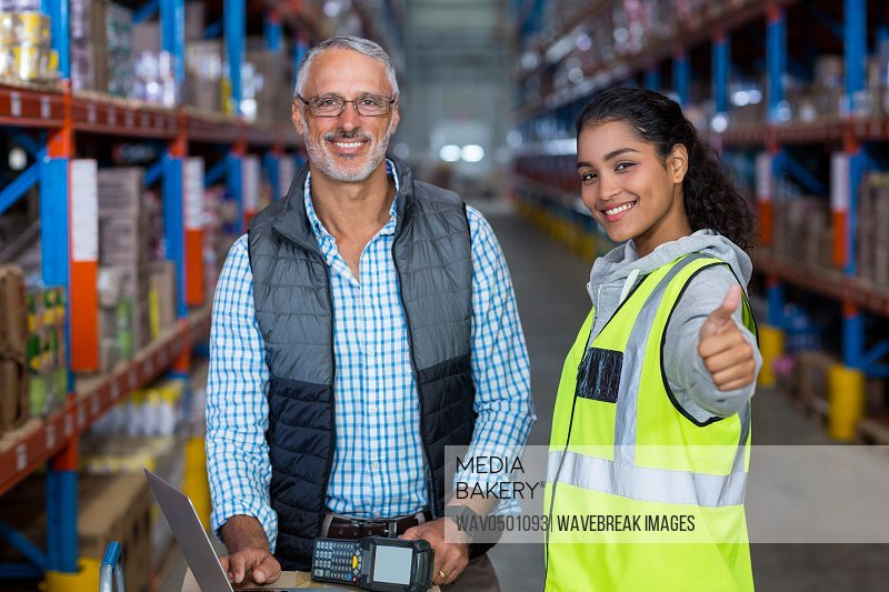 Portrait of warehouse workers working together in warehouse