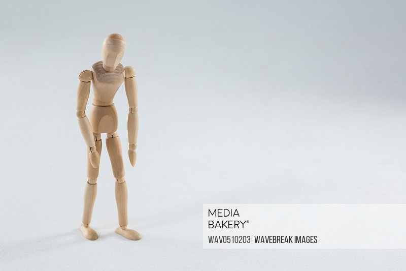 Tired wooden figurine on white background