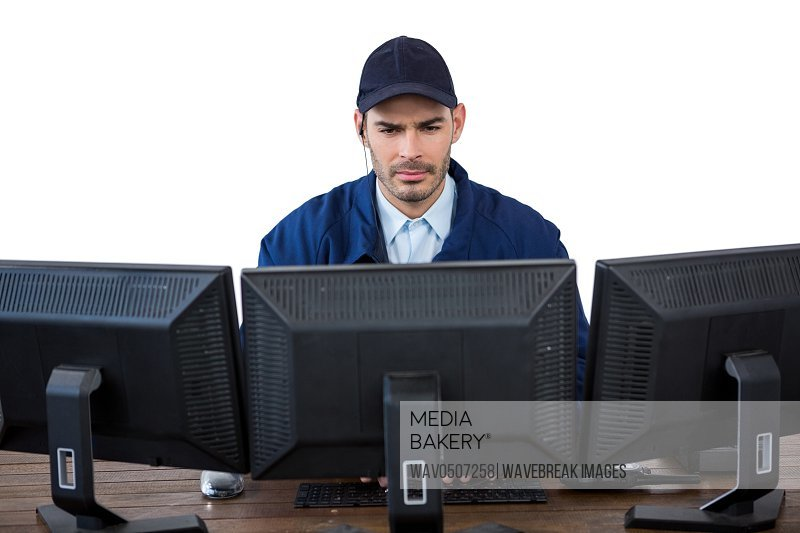 Security officer using computer against white background