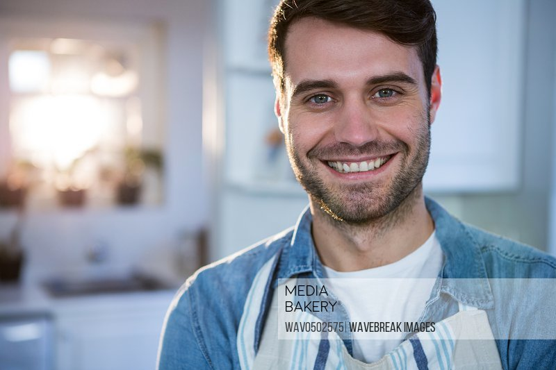 Portrait of man standing in the kitchen