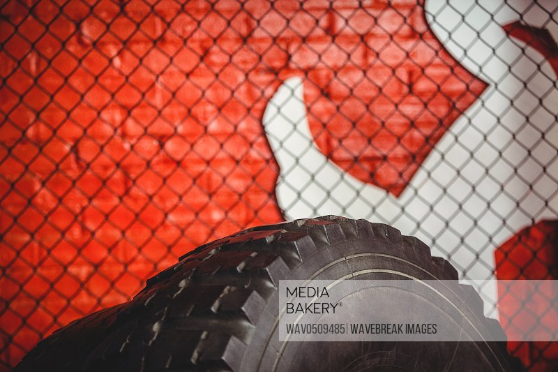 Close-up of sledgehammer tire in fitness studio