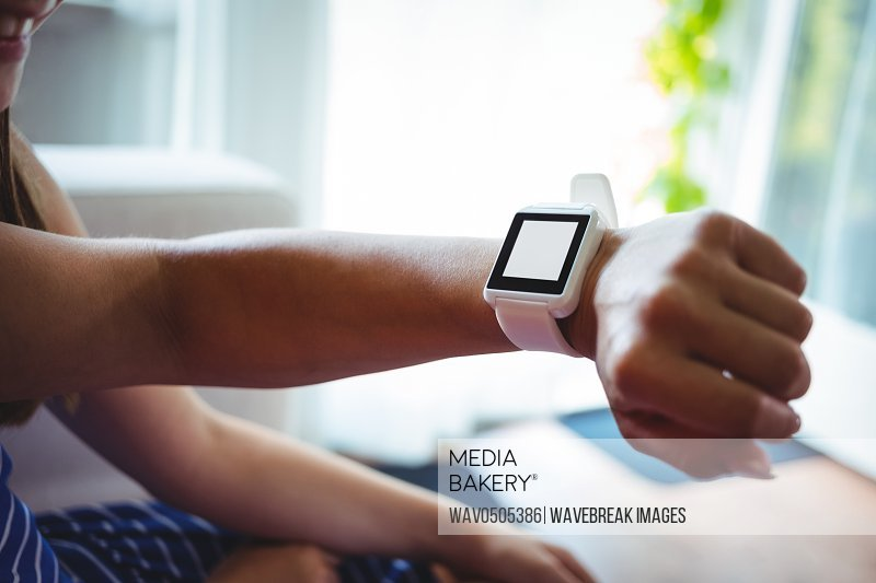 Close-up of hand wearing smart watch