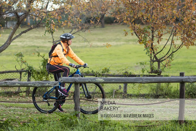 Female biker cycling in countryside track