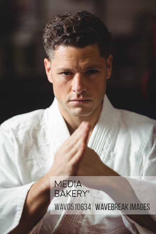 Portrait of karate player practicing at arena