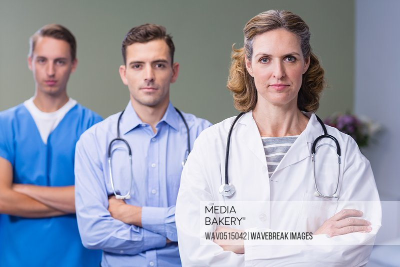 Portrait of doctors standing with arms crossed