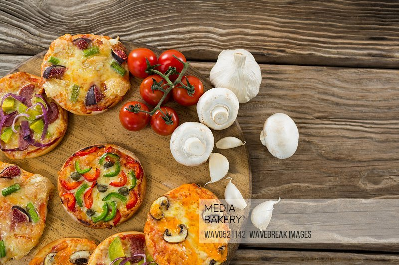 Various pizza with tomatoes and garlics