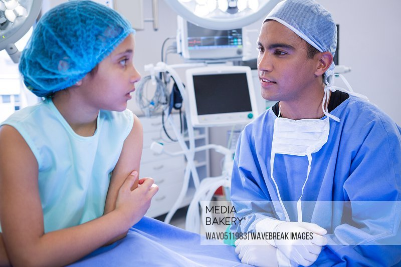 Doctor interacting with patient in operation room at hospital