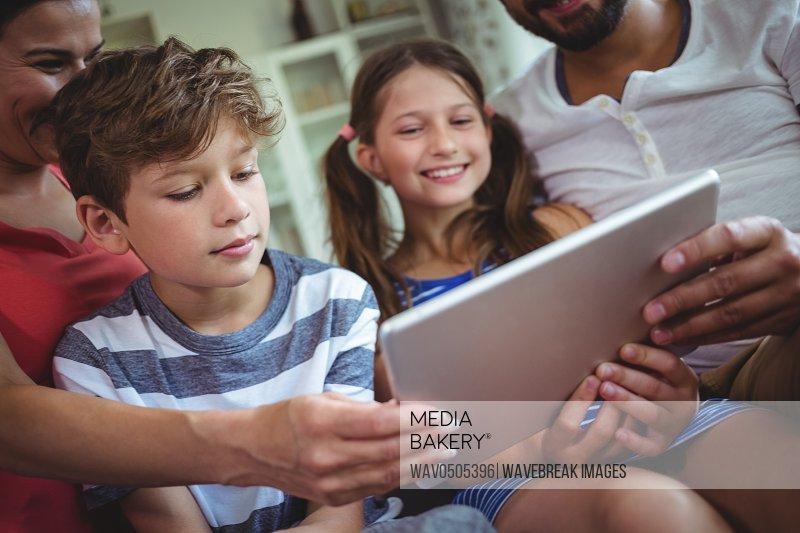 Family using a digital tablet at home