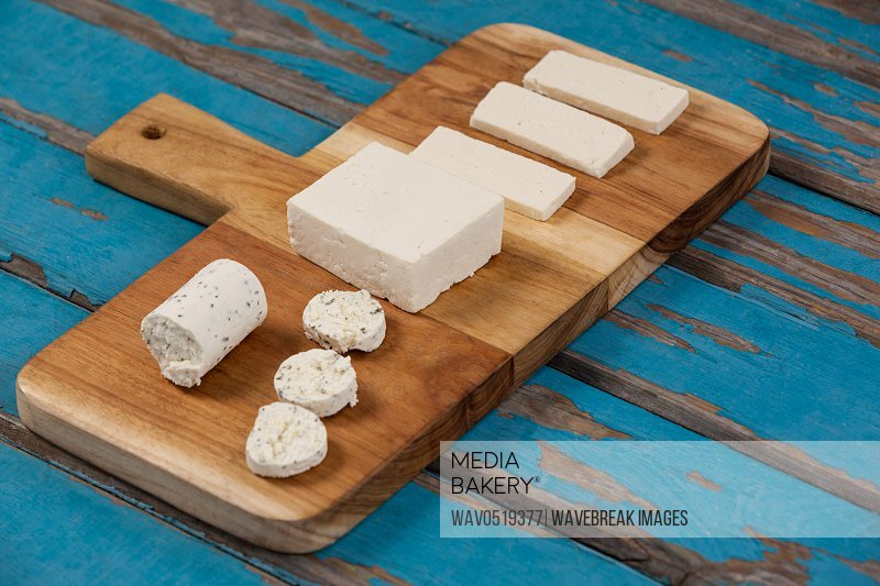 Variety of cheese arranged on chopping board