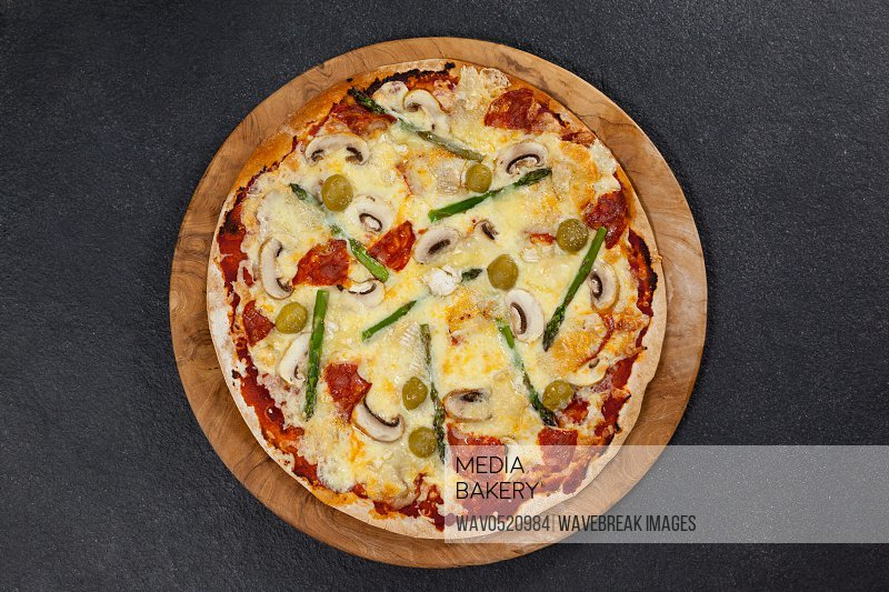 Delicious italian pizza served on wooden board
