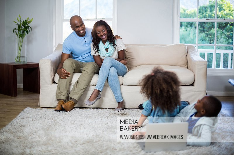 Children interacting with parents at home