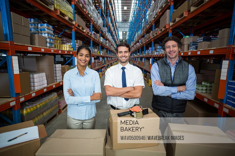 Warehouse team smiling at camera in the warehouse
