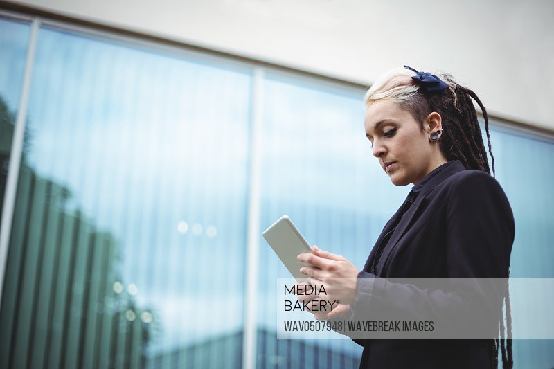 Businesswoman using digital tablet in office campus