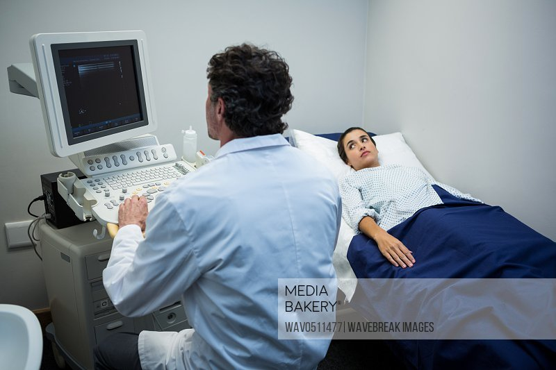 Doctor using sonography machine in hospital