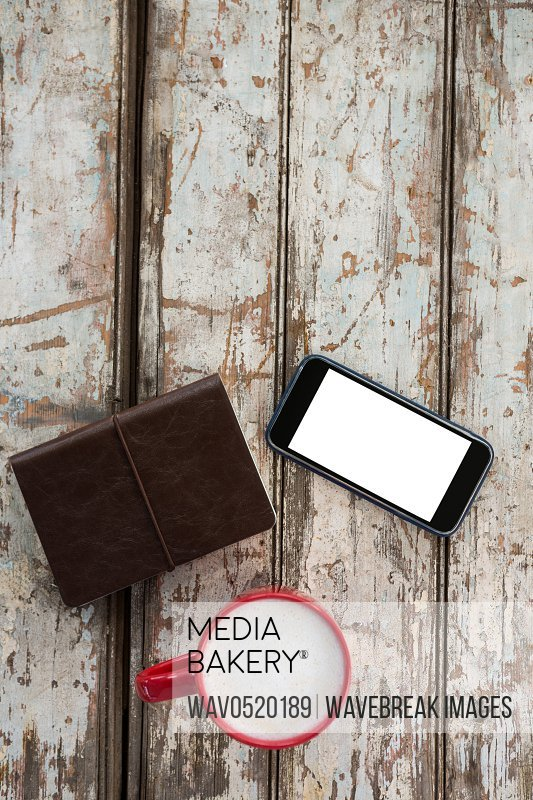 Cup of coffee with smartphone and organiser