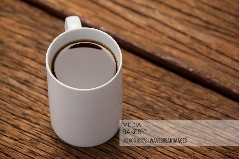 Cup of coffee on wooden table