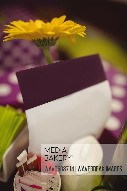 Flower and greeting cards on table setting