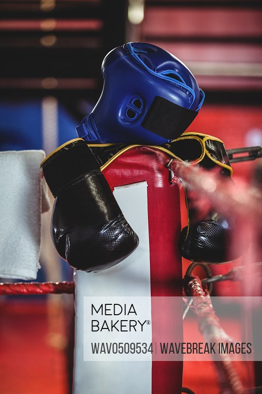 Close-up of boxing gloves, headgear and a towel kept on boxing ring