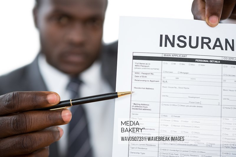 Close-up of businessman showing insurance document