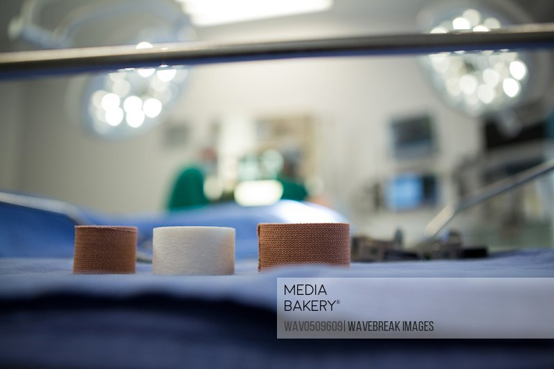 Three bandage reel on surgical tray in operation theater of hospital