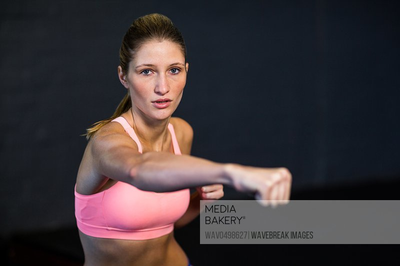 Portrait of woman practicing boxing in fitness studio
