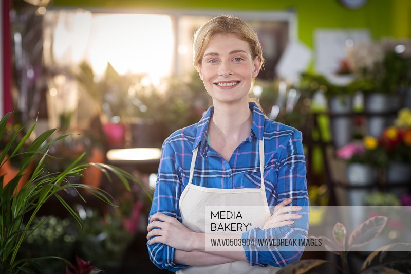 Portrait of female florist smiling in the shop