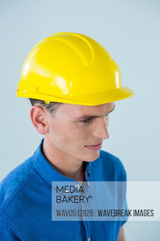 Close-up of confident engineer against white background