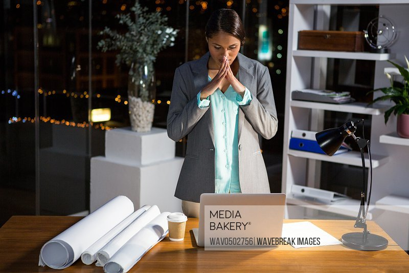 Frustrated businesswoman working in office at night