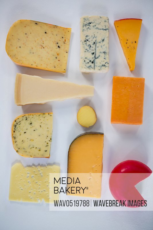 Variety of cheese on white background