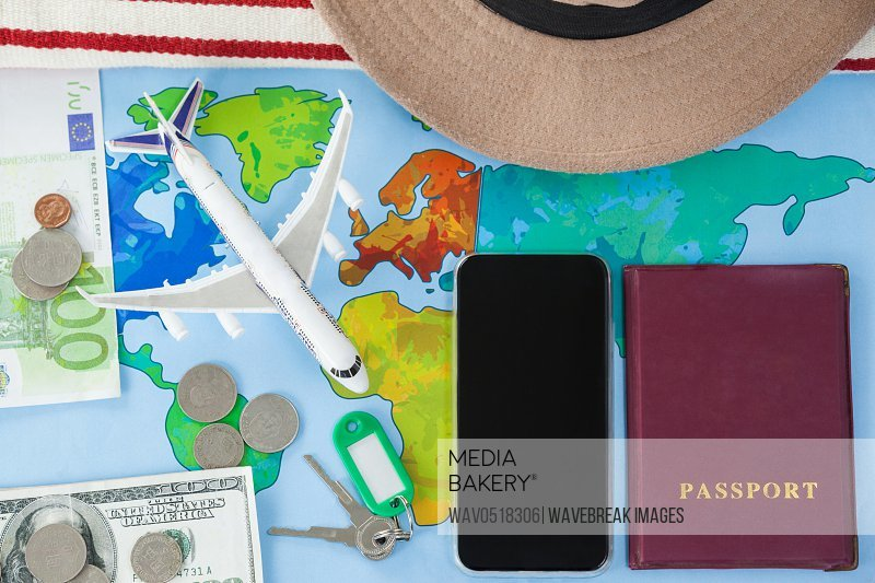Map smart phone passport and cash placed together
